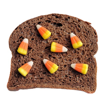 An unhealthy halloween snack. A candy corn and bread sandwich! photo