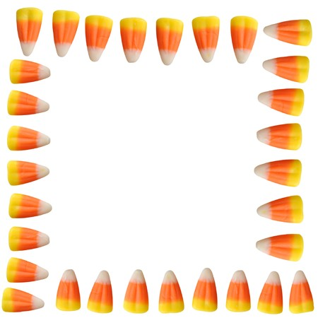 Halloween candy corn arranged in a border isolated on white background Stock Photo - 7850416