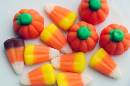 A pile of Halloween candy corn on a white background. photo