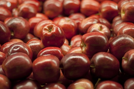 A bunch of red apples piled up at the supermarket. photo