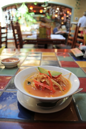 A bowl of tortilla soup in restaurant