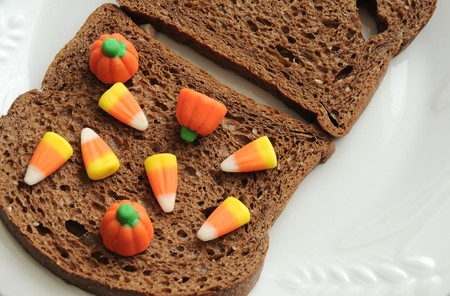 An unhealthy halloween snack. A candy corn and bread sandwich! Stock Photo - 7936353