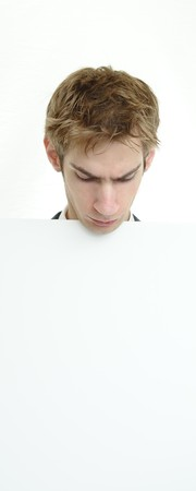 Young businessman holding a white cardboard sign with copyspace above and below Stock Photo - 7936357
