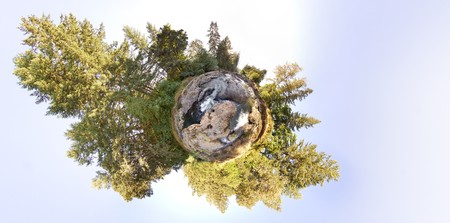 mapped: A little tiny planet of an earhtly rocky river with trees and sky. This is an equirectangular panorama mapped into stereographic form.