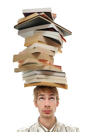 A young adult teenage man with stacks of books on top of his head. Isolated on white background. Stock Photo - 8078401