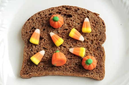 An unhealthy halloween snack. A candycorn and bread sandwich! photo