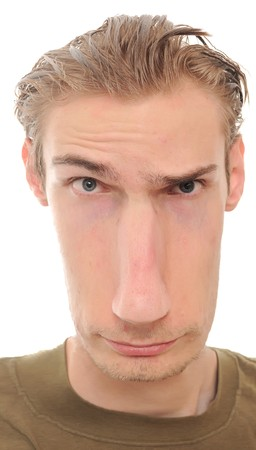 warped: A young man with a really long distorted face isolated on white background Stock Photo