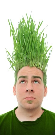 botanical farms: A young man looking upward at the grass growing from the roots on top of his head. This concept can apply to environmentalists, farmers, agriculture, landscapists, gardeners, and crazy haircuts. Stock Photo