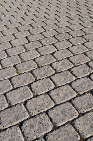 pavers: A cobblestone path with square bricks showing perspective. Stock Photo