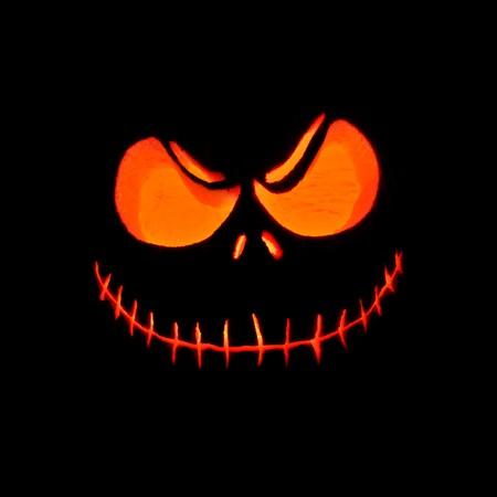 Halloween Jack-O-Lantern Pumpkin glowing in the darkness Stock Photo - 8078507