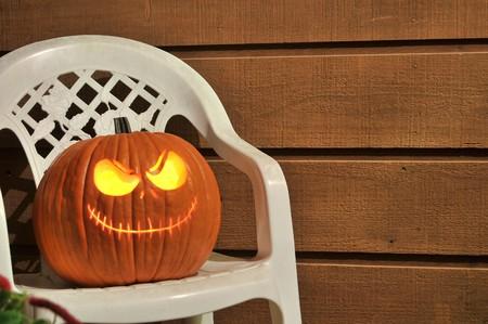 Halloween Jack-O-Lantern Pumpkin glowing in the darkness photo