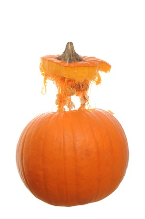 mid air: Orange pumpkin  isolated on a white background with its top floating above it in mid air.