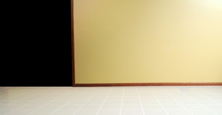 Empty room with a linoleum floor with a yellow painted wall Stock Photo - 8139069