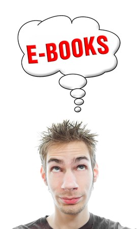 Young white Caucasian male adult thinks about getting into ebooks in a think bubble isolated on white background photo