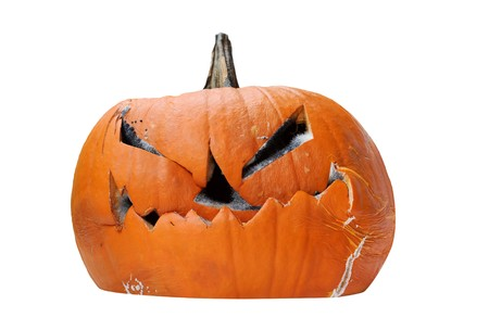 Scary rotting halloween pumpkin jack-o-lantern unlit, isolated on white background