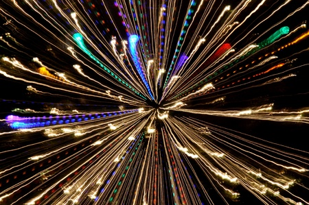Exploding blasts of sparks burst out into the darkness of space and time Stock Photo
