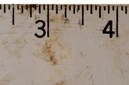millimetre: Macro closeup of a grunge metal measuring ruler Stock Photo
