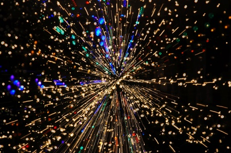 discharge time: Exploding blasts of sparks burst out into the darkness of space and time Stock Photo