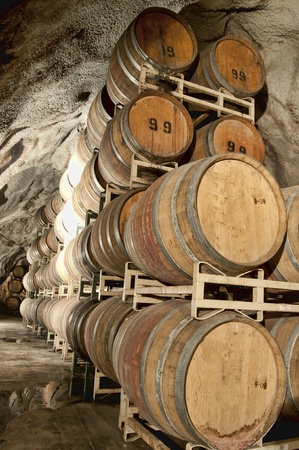 Wine keg barrels stacked underground to keep cool. Stock Photo