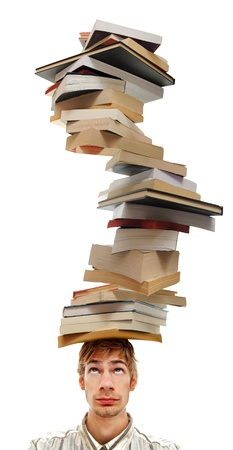 A young adult teenage man with stacks of books on top of his head. Isolated on white background. photo