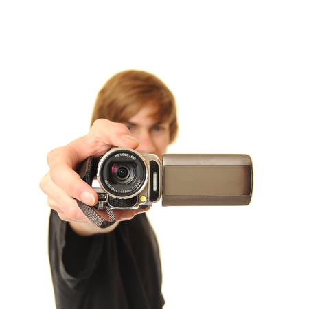 Young adult man holding a camcorder isolated on white background. This image works great for demonstrating the power of Online Video. Stock Photo - 8573760
