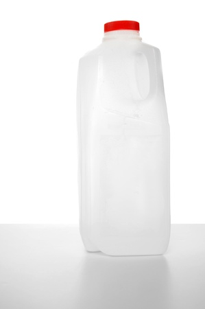 Milk carton with red label on a shiny table with white background. 1 Liter. photo