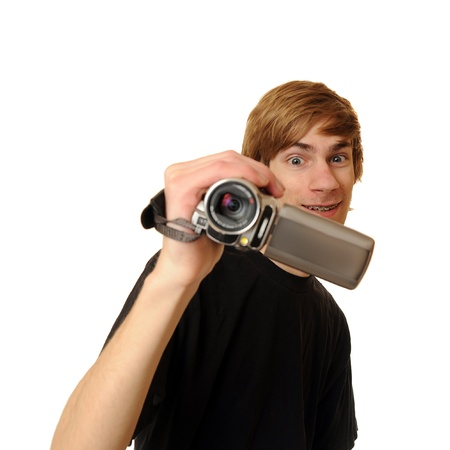 Teen holding a camcorder isolated on white background photo