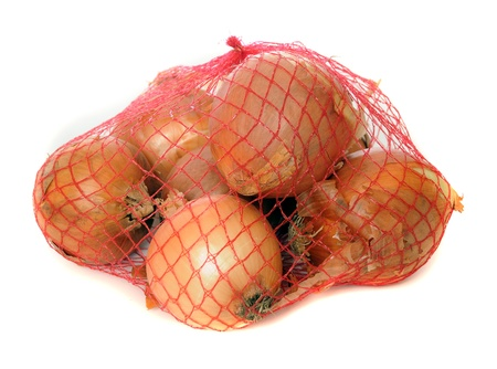 Onions isolated on white in a fishnet. photo