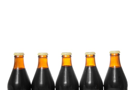 6 pack beer: Five beer bottles isolated on a pure white background with blank copyspace above with room for your text.