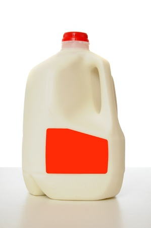 jugs: 1 Gallon of Milk in a milk carton on a shiny table with white background.  Stock Photo