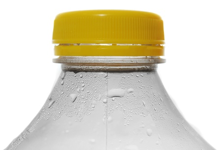 thirst quenching: water bottle with cold thirst quenching condensation dripping off of the edge of the plastic container