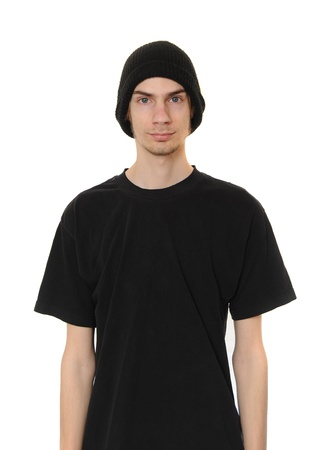 A white caucasain young adult wears a black beanie hat and a black casual t-shirt isolated on white background.