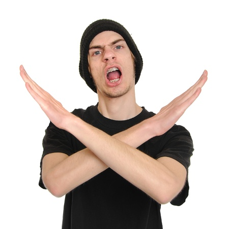 extremist: Young man pumped up, making an X shape for Extreme with his arms and hands.  Stock Photo