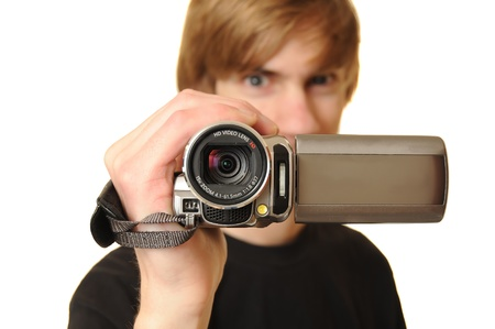 Young adult man holding an HD camcorder isolated on white background photo