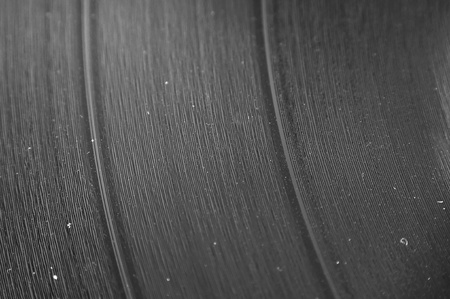 grooves: A macro closeup of an LP record with dust in the grooves