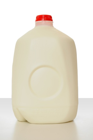 gallon: 1 Gallon of Milk in a milk carton on a shiny table with white background.  Stock Photo