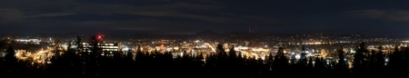 City skyline panorama taken at night in Eugene, Oregon.