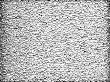 A closeup macro texture of white extruded polystyrene foam Stock Photo