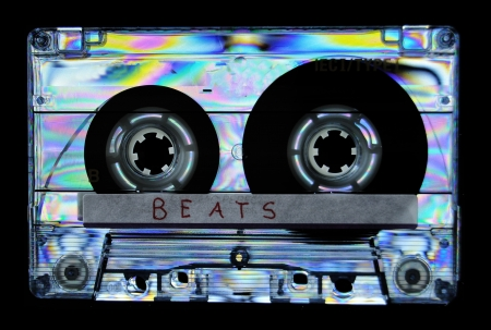 Cassette tape in cross polarized light creates a psychedelic rainbow color on the plastic. Isolated on black background