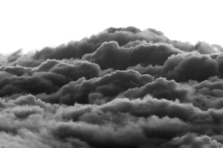 Dark heavenly clouds in the sky. This photograph was taken at 10,000 feet elevation and shows the clouds forming in a more dramatic way. Isolated white background copyspace above. photo