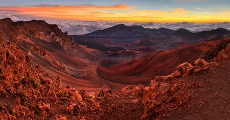 Volcanic crater landscape with beautiful orange clouds at sunrise taken at Haleakala National Park in Maui, Hawaii. photo