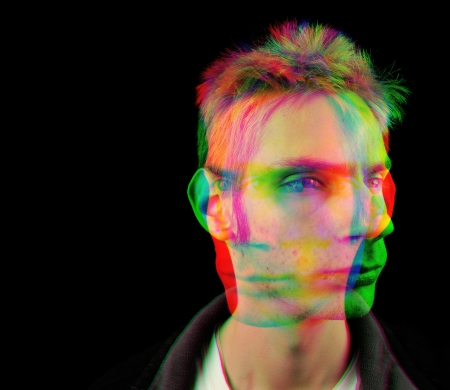 Portrait depicting a young man getting high and experiencing an altered state from intoxicating hallucinogenic psychedelic drugs.