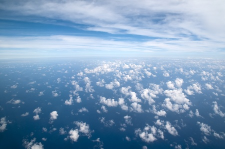 Photograph taken above the clouds over the Pacific Ocean. photo