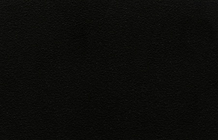 An abstract neutral background of textured black stone Stock Photo - 9194392