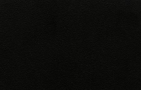 An abstract neutral background of textured black stone Standard-Bild