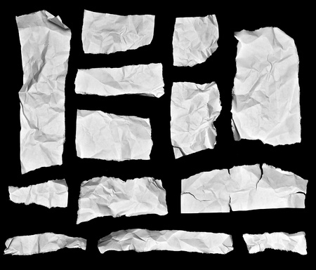 A collection of white torn paper pieces isolated on black background. Great for using as a backdrop for text or images. Stockfoto
