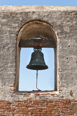 church bell: old rustic bell located at The Mission in Californa