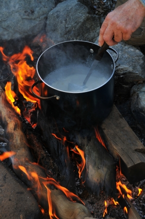 Pot of soup on a camping fire Stock Photo - 9749348
