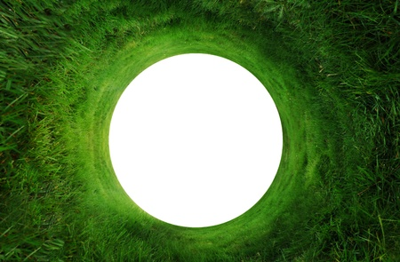 Abstract background of green grass going around in a circle with a white copyspace in the middle. Could make a hole in one golf background. photo