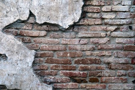 masonary: An old worn down red brick wall with plaster on the sides make a great background with copyspace Stock Photo
